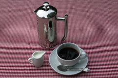 Shiny coffee pot and cup Royalty Free Stock Photo