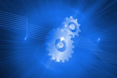 Shiny cogs on blue background Royalty Free Stock Photo