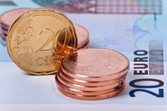 Shiny Coins. Shiny euro coins stacks and banknotes as close up view Royalty Free Stock Photography