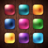 Shiny Colored Square Buttons on Wooden Background. Attractive Nine Shiny Colorful Square Buttons on Brown Wooden Background Stock Image