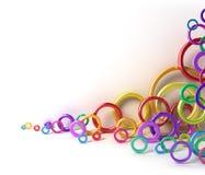 Shiny colorful circles under white wall Stock Photos
