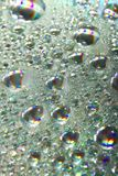 Shiny colorful drops of water Royalty Free Stock Image