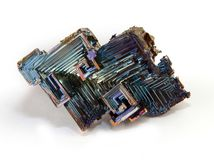 Shiny colorful mineral bismuth on a white background. Rainbow colorful mineral bismuth closeup macro  on white background Stock Images