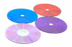 Shiny colors of technology. Four different CD (DVD) discs isolated on white Royalty Free Stock Images