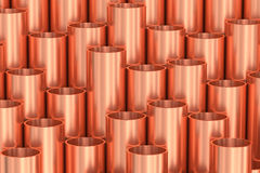 Shiny copper pipes industrial background. Heavy metallurgical industry production and non-ferrous industrial products creative abstract illustration: many Stock Photo