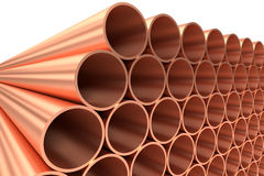 Shiny copper pipes in rows diagonal view. Heavy metallurgical industry production and non-ferrous industrial products creative abstract illustration: many Stock Photo