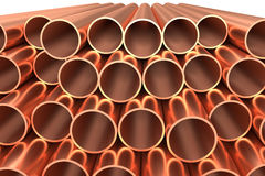 Shiny copper pipes in rows isolated. Heavy metallurgical industry production and non-ferrous industrial products creative abstract illustration: many stainless Royalty Free Stock Photo