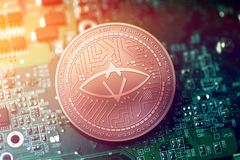 Shiny copper SINGULAR DTV cryptocurrency coin on blurry motherboard background. Token Stock Photo