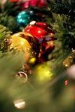 Shiny dangling Christmas tree ornaments Stock Photography