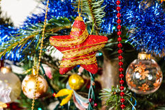 Shiny decorations in Christmas tree Royalty Free Stock Images