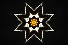 Shiny decorative star. Illustration of shiny star with black background Royalty Free Stock Image