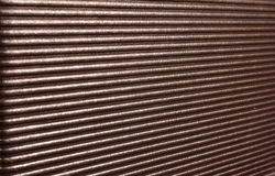 Shiny Diagonal Lines Background. A background of a pattern of diagonal lines on a shiny surface Stock Image