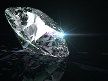 Shiny diamond on black background. Stock Images