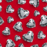 Shiny diamond hearts on dark red background Stock Images