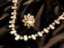 Shiny diamond jewelry necklace on black satin background for valentines day. Royalty Free Stock Image