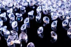 Shiny diamonds on a black background stock image