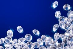 Shiny diamonds on a blue background royalty free stock image