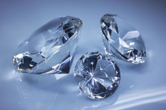 Shiny diamonds jewel on dark blue Royalty Free Stock Photo