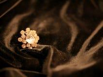 Shiny diamond rose jewelry on black satin background for valentines day. stock photography