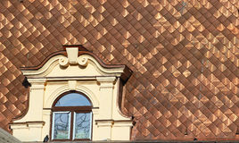 Shiny dirty copper roofing with attic window Royalty Free Stock Photography