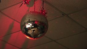 Shiny disco ball in empty nightclub stock video