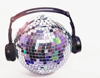 Shiny disco ball with headphones Stock Image