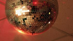 Shiny disco ball rotating in empty nightclub stock video