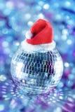 Shiny disco ball in santa hat. Shiny disco ball in red santa hat Stock Image