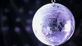 Shiny disco ball spinning around Stock Photo