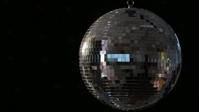 Shiny disco ball spinning Stock Photos