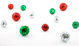 Shiny Disco Balls in Christmas Colors. On White Background royalty free stock image
