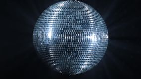 Shiny disco mirror ball rotating stock video