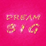Shiny Dream Big Phrase on Pink Backdrop Stock Photography
