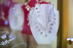 Shiny earrings and necklace Stock Photos