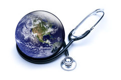 Shiny Earth and stethoscope. Concept for global medicine with stethoscope reflected in shiny Earth. Isolated on white. Globe public domain courtesy http:// Stock Photos