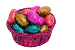 Shiny easter egg pink basket Royalty Free Stock Images