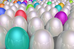 Shiny eggs. A group of shiny reflective silver eggs mixed with eggs in bright colors Royalty Free Stock Images