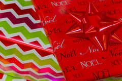 Shiny elegant Christmas gifts closeup background with bow in upper right corner, classy lettering noel. Shiny elegant Christmas gifts closeup background with bow stock photo