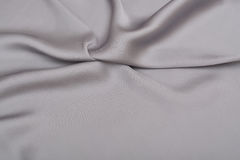 Shiny elegant silver satin silk fabric background Royalty Free Stock Images