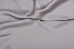 Shiny elegant silver satin silk fabric background Royalty Free Stock Images