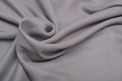 Shiny elegant silver satin silk fabric background Stock Images