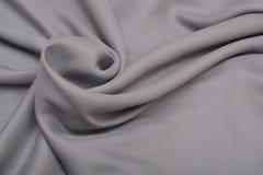 Shiny elegant silver satin silk fabric background Stock Images