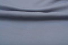 Shiny elegant silver satin silk fabric background Royalty Free Stock Photography