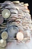 Shiny euro coins frozen in ice Stock Photo