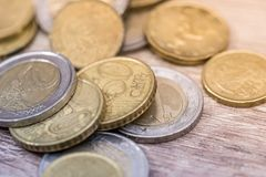 Shiny euro coins on the table. Close up Royalty Free Stock Image