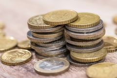 Shiny euro coins on the table. Close up Royalty Free Stock Photos