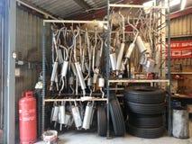 Shiny Exhausts. Workshop car vehicle royalty free stock photo