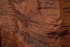 Shiny fabric. A brown very shiny fabric Stock Photo
