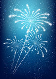 Shiny fireworks on blue. Background Royalty Free Stock Photography