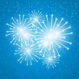 Shiny fireworks on blue. Background Royalty Free Stock Image